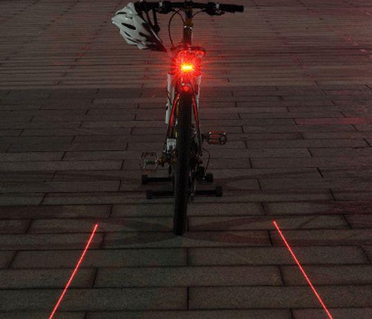 Bezpečnostní zadní LED svítilna na jízdní kolo se zabudovaným laserem